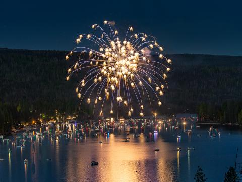 Fireworks exploding over the picturesque Bass Lake for Independence Day
