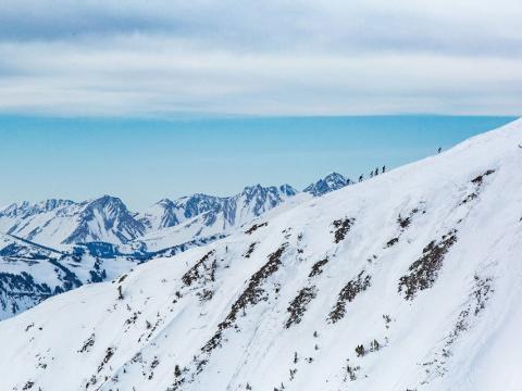 Skiing uphill during a Shedhorn Skimo long-distance ski race in Big Sky, Montana