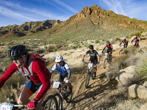 Competing in the Puzzler Mountain Bike Race in El Paso, Texas