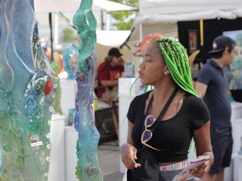 Checking out pieces at the Columbus Arts Festival
